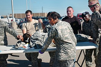 2009 Fort Hood shooting - A shooting victim being transported to a waiting ambulance