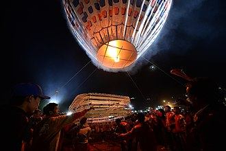 Tazaungdaing festival - Fireworks being attached to a hot air balloon at the fireworks competition during Tazaungdaing in Taunggyi