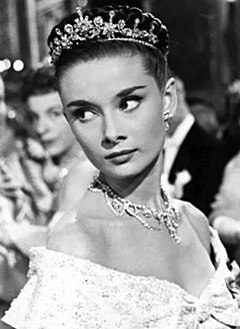A photograph of Hepburn as Princess Ann in the film Roman Holiday.
