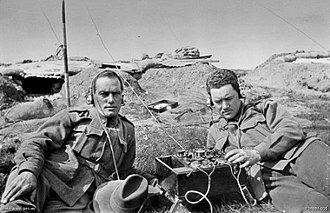 1st Australian Wireless Signal Squadron - A pair of Australian signallers, each wearing a headphone set, listen in on an early Marconi Mk III crystal shortwave tuner set. The men are probably conducting a training exercise at the signalling school at Broadmeadows, Victoria