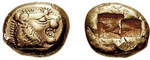 Ancient Greek coinage - Uninscribed electrum coin from Lydia, 6th century BCE. Obverse: lion head and sunburst Reverse: plain square imprints, probably used to standardise weight