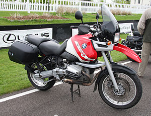 Red and white BMW R1100GS motorcycle with panniers