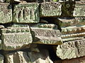 Banteay Kdei - 018 Piled up Remains (8582343598).jpg