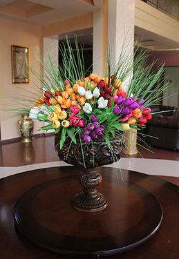 Bouquet in the wooden carved vase.jpg