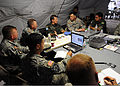 Brazilian military Gen. Floriano Peixoto, commander of United Nations Stabilization Mission in Haiti, asks a few questions at a brief with U.S. Army Lt. Gen. P.K. Keen, deputy commander of U.S. Southern Command 100311-N-HX866-001.jpg