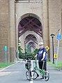 Brompton tourist under Hellgate arcade jeh.jpg