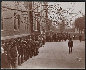 Kings County Hospital Center - A line in front of the Brooklyn Almshouse - 1900