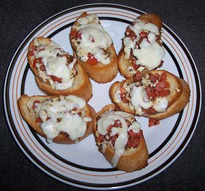 French bread topped with mozzarella cheese, to...