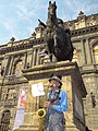 Busking Saxophonist beneath Equestrian Sculpture - Centro - Mexico City - Mexico (6450785057).jpg