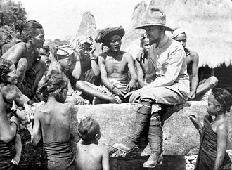 Sumba people - A Protestant missionary minister, Wiebe van Dijk sitting on a Sumbese tomb, preaching the Gospel to the people of Sumba, circa 1925–1929.