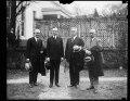 Calvin Coolidge and group outside White House, Washington, D.C. LCCN2016888625.tif