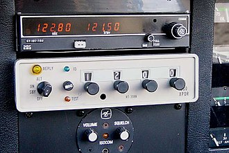 "Transponder (aeronautics) - Cessna ARC RT-359A transponder (beige box), beneath a VHF radio.  In this example, the transponder code selected is 1200 for VFR flight (in North American airspace). The green IDENT button is marked ""ID""."