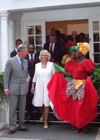 Monarchies in the Americas - Prince Charles, Prince of Wales (far left), heir to the Jamaican throne, and his wife, Camilla, Duchess of Cornwall (centre), at the Half Moon Hotel, Montego Bay, 13 March 2008