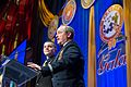 Chief of Staff of the U.S. Air Force Gen. Mark A. Welsh, right, speaks on stage after receiving the Honor Guard Award with the surviving son of Army Sgt. 1st Class Carlos Santos-Silva March 27, 2014, during 140327-D-KC128-443.jpg
