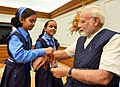 Children tying 'Rakhi' on the Prime Minister, Shri Narendra Modi's wrist, on the occasion of 'Raksha Bandhan', in New Delhi on August 07, 2017.jpg