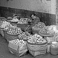 Chinese Woman selling fruits in the street.jpg