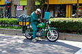 Chunghwa Post Mail Carrier Ride on Motorcycle Checking Bag in Wait Traffic Sign 20150401.jpg