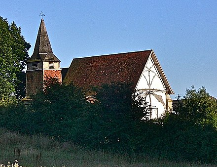 St Mary's church with exposed timber framing visible on the west wall.[2]