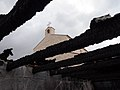 Church of the Multiplication as seen through the burnt roof of an auxiliary building.jpg