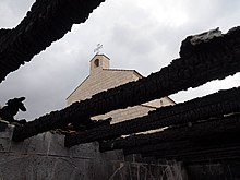 Photo showing the Church of the Multiplication after an arson attack on the adjacent library building.