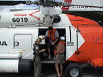 Coast Guard rescues two men from capsized boat DVIDS1098066.jpg
