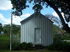 Miami-Dade County Public Schools - First Coconut Grove Schoolhouse, currently located on the grounds of Plymouth Congregational Church, Coconut Grove, Florida.