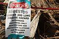 Crews remove asbestos debris 110729-A-DW629-021.jpg