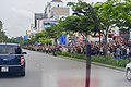 Crowds Anticipating the Arrival of President Obama Greet Secretary Kerry as He Drives Through the Streets of Ho Chi Minh City (27237283116).jpg