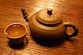 Cup of green tea and tea pot on table.jpg