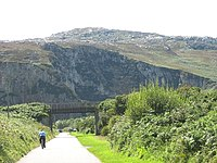 Cyclist on the road leading to the Breakwater Country Park - geograph.org.uk - 1415832.jpg