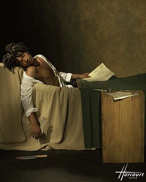 Doc Gynéco - Doc Gynéco in 1997. The photo by Studio Harcourt alludes to the 1793 painting The Death of Marat.