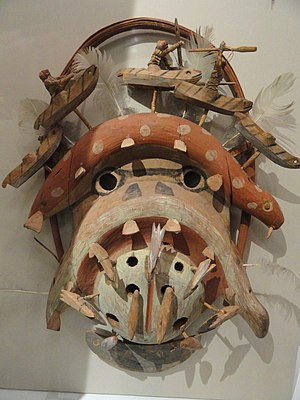 Yup'ik masks - A Yup'ik/Cup'ik  dance mask (kegginaquq) with the head of walrus yua. Toggle harpoon points are appended to the lower face, over which two walrusses figures arch, topped by hunters in kayaks. Mask collected from old village of Qissunaq (or Kushunak, the location is near the modern village of Chevak, Alaska) in 1905 by Tununak trader I. A. Lee. Peabody Museum of Archaeology and Ethnology, Harvard University.