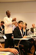 Daniel Ddiba (Makerere University) raising questions (15532826651).jpg