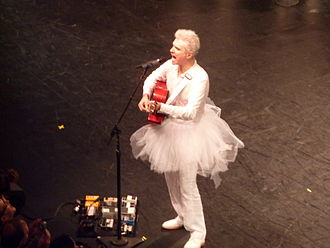 Everything That Happens Will Happen Today - The performances on the Songs of David Byrne and Brian Eno Tour included matching costumes, such as the white jumpsuit and tutu that Byrne is wearing here.