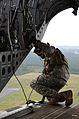 Defense.gov News Photo 100920-A-1224C-039 - A U.S. Army crew chief from the 160th Special Operations Aviation Regiment Airborne checks a landing zone from the ramp of an MH-47G Chinook.jpg