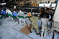 Defense.gov News Photo 110326-F-XC395-015 - U.S. airmen members of the Japan Ground Self-Defense Force and various Japanese civilian agencies load water hoses onto a truck at Yokota Air.jpg