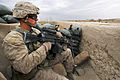 Defense.gov News Photo 120327-M-9581M-511 - U.S. Marine Corps Cpl. Daniel Thompson provides security while members of an Afghan narcotics interdiction unit search a compound during Operation.jpg