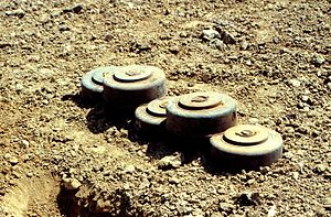 Anti-handling device - A stack of five M15 mines dating from the 1960s. The top two mines show additional fuze wells