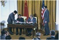 Deng Xiaoping and Jimmy Carter sign diplomatic agreements between the United States and China - NARA - 183270.tif