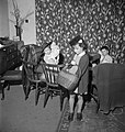 Doreen Buckner and her brother and sister play at shopping in their London home during the night-time 'Blackout' in 1943. D17276.jpg