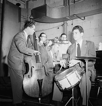 Kai Winding - (From left:) Eddie Safranski, Kai Winding, Stan Kenton, Pete Rugolo, and Shelly Manne, c. January 1946.  Photograph by William P. Gottlieb