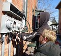 Electricians installing separate panels for meters on multifamily house in NJ.JPG