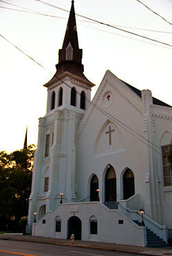 A white-painted church at sunset.