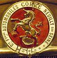 Emblem Corre.JPG