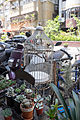 Empty Bird Cage in Front of Flower Shop 20150329.jpg