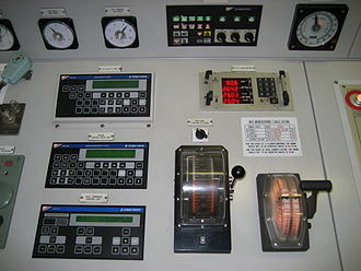 Engine order telegraph - Modern engine room telegraph/remote control handle in Engine Control Room (ECR) on board a merchant ship. ECR Lever is not currently active as the system pictured is in direct bridge control mode.