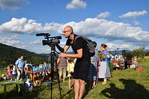 Video ethnography - Ethnographer filming celebrations of the Assumption of Mary, Beskids, Poland