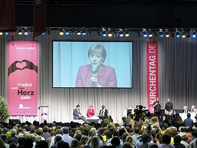 Merkel speaking at the 2011 German Evangelical Church Assembly in Dresden. Ev Kirchentag 2011 in Dresden 71.jpg