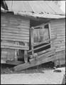 Exterior of three room house which rents for $4 monthly. This property, formerly owned by a coal mining company, is... - NARA - 541172.tif