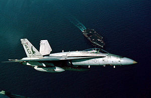 F-18C VFA-136 over USS Eisenhower (CVN-69) 1992.JPEG